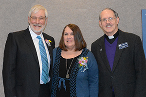 Art Roche poses with his wife Diane and DWC college president, Fr. Tom Ascheman, SVD